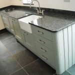 lamp room grey shaker with blue pearl granite and riven slate floor