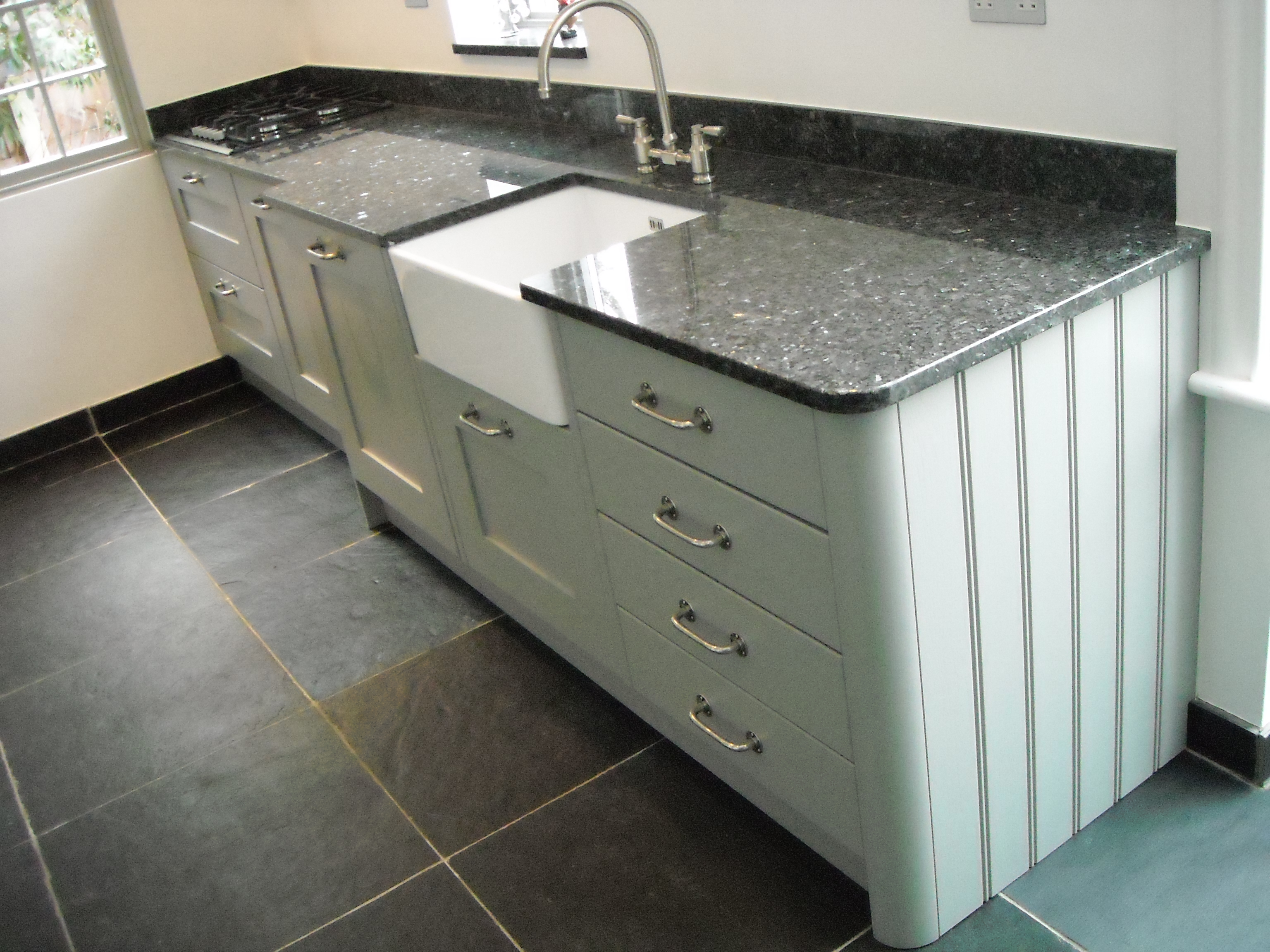 White kitchen cabinets with emerald pearl granite - Lamp Room Grey Shaker With Blue Pearl Granite And Riven Slate Floor