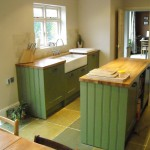 painted shaker with oiled oak worksurfaces and riven slate floor