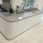 handleless white gloss with unistone savoy quartz