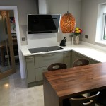 london stone slab, unistone bianco stone, walnut dining bar and moleanos blue limestone floor
